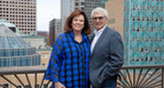 Larry and Caryl Abdo pose in downtown Minneapolis