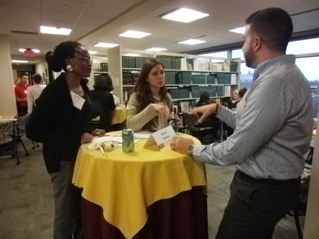Alumni Networking at a Table